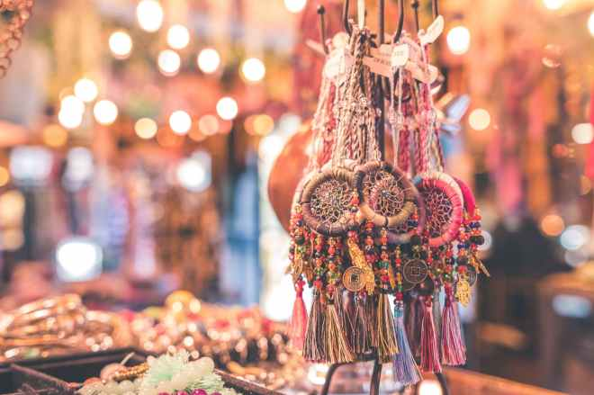 person showing assorted dream catcher keychain lot in tilt shift photography
